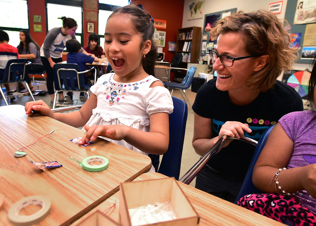 . BEST 1111 Jessica Guerro reacts to the robot she built with the help of Janet Hollingsworth of the Blg61 Boulder Public Library Makerspace during the I Have A Dream summer STEM conference at Peak to Peak Charter School in Lafayette on Thursday.  For more photos go to dailycamera.com Paul Aiken Staff Photographer June 7, 2018