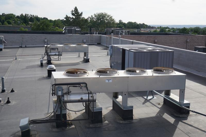 Liebert condensing unit 1 in foreground, Carrier rooftop unit to right, Liebert condensing unit 3 in background.