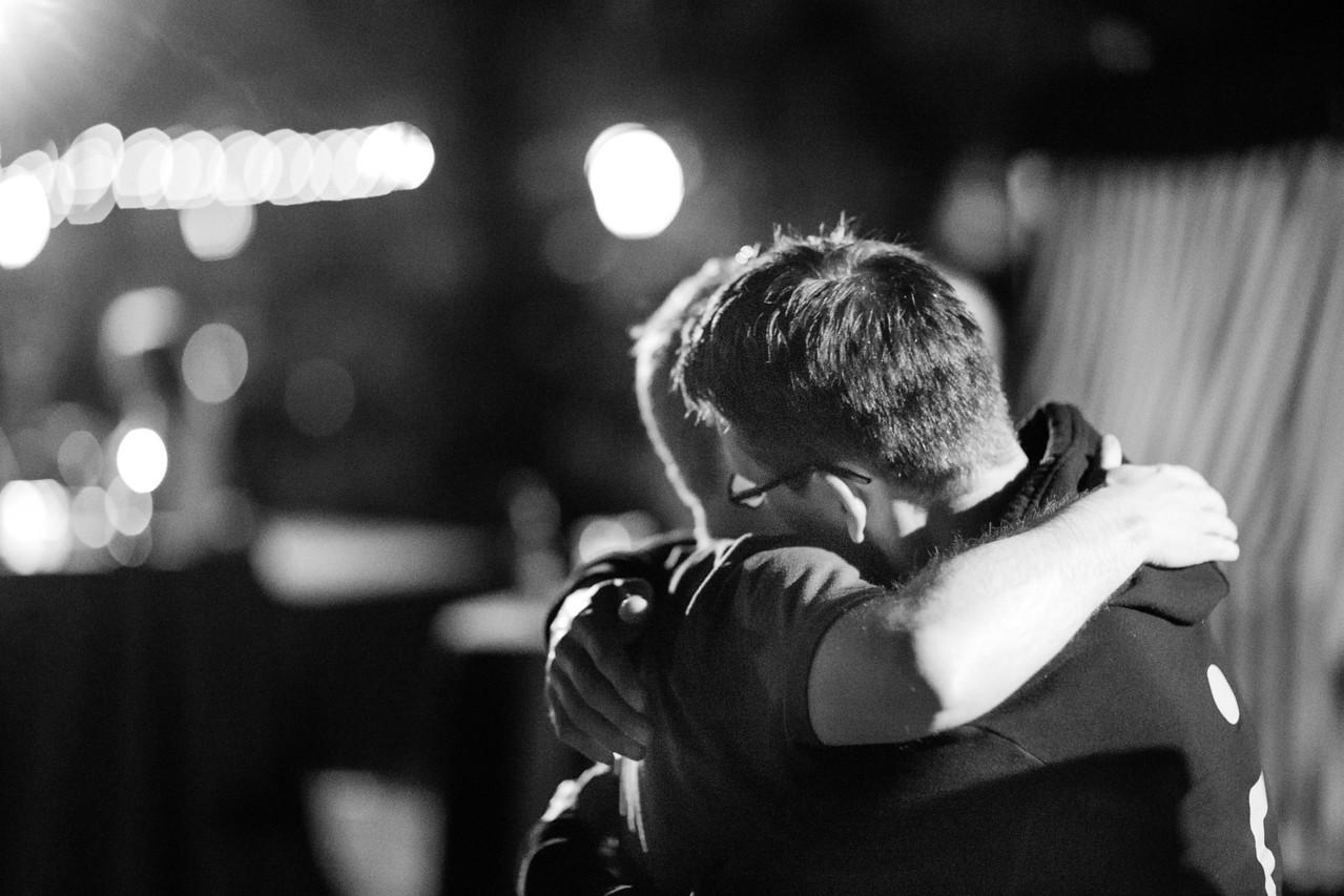 Evan Deffley and Lee Shepherd hug it out.