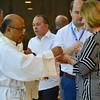 Fr. Kus distributes communion