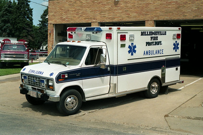 MILLEDGEVILLE AMBULANCE FORD 3-  WHITE - BLUE STRIP DRIVERS SIDE