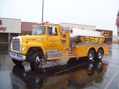 LINCOLN RURAL FPD TANKER 75  FORD L8000 - TOWERS