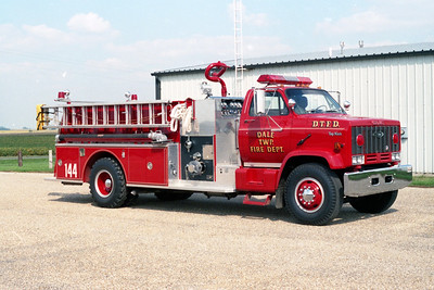 DALE TOWNSHIP FPD  ENGINE 144  1987  GMC TOP KICK - PIERCE   750-1000   OFFICERS SIDE