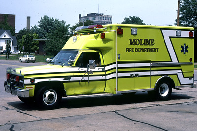 MOLINE  AMBULANCE 2  1984 CHEVY-WHEELED COACH   RON HEAL PHOTO