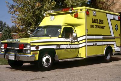 MOLINE AMBULANCE 3  1984 CHEVY-WHEELED COACH   RON HEAL PHOTO