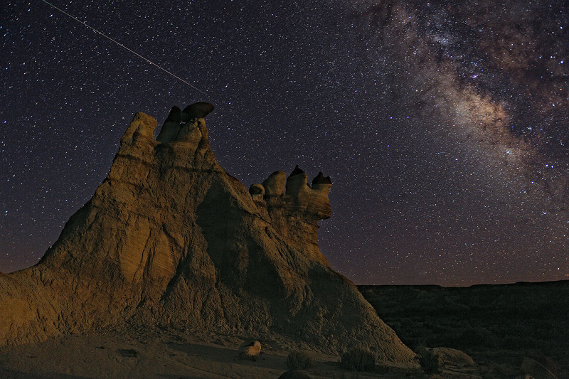 """CANYON COSMOS"" - A meteor streaks across the starry sky during the Perseid meteor shower with the Milky Way in the background in a remote corner of the Hopi Reservation in Arizona."