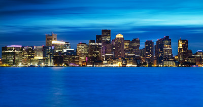 "A long exposure of the Boston Skyline during the ""Blue Hour"" , an hour after sunset . Photo taken from the Hyatt Harborside."