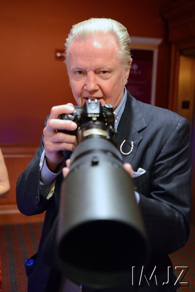 Actor Jon Voight asked to hold this photographers heavy 300mm lens at Churchill Downs on Derby day. May 7, 2016.