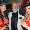 Jonathan Goldsmith, actor best known for his role as The World's Most Interesting Man in the Dos Equis beer commercials, is flanked by fans Monica Hoyos and Misty Ingram at Churchill Downs, May 7, 2011.