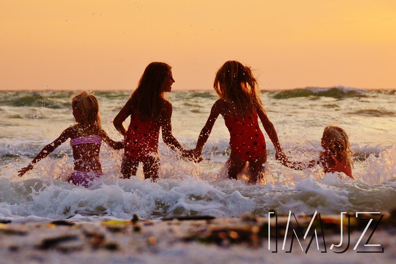 Girls frolic in the ocean waves off the coast of Marco Island, FL.