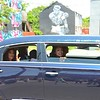 "Members of Muhammad Ali's family in the funeral procession pass by a mural depicting ""The Greatest of All Time"" on East Broadway Friday morning. June 10, 2016."