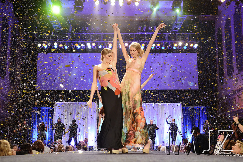 Models Sarah Julien and Abby Hendershot on the runway for the KDF Fashion Show at Horseshoe Casino Thursday night. March 28, 2014.