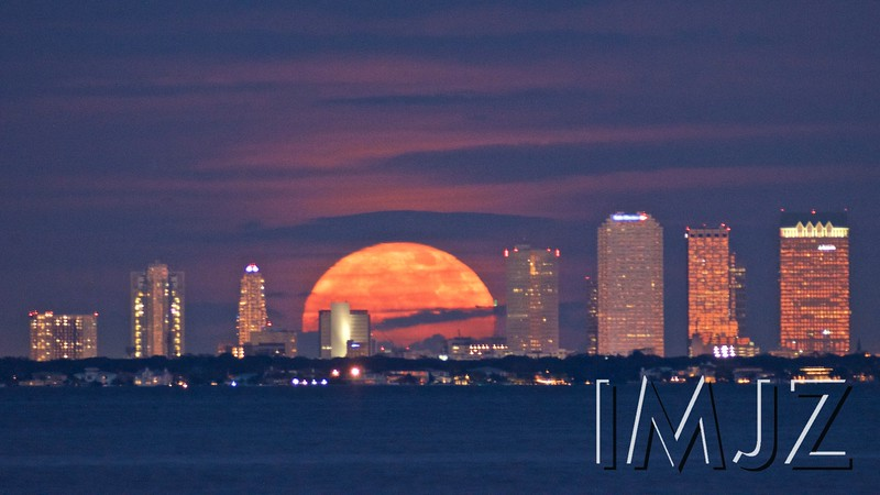 The full moon rise over downtown Tampa, FL, as seen from St. Petersburg across Tampa Bay. Sunday December 3, 2017. Photo by Jacob Zimmer