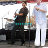 ATLANTIC CITY, NJ - JULY 04:  John Stamos (L) plays guitar and sings with the Beach Boys lead singer Mike Love  as they perform for an estimated 50,000 fans in front of the Atlantic City Hilton on July 4, 2008 in Atlantic City, New Jersey.