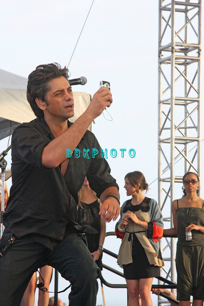 ATLANTIC CITY, NJ - JULY 04:  John Stamos uses a video camera to video the  Beach Boys as they  perform for an estimated 50,000 fans in front of the Atlantic City Hilton on July 4, 2008 in Atlantic City, New Jersey.