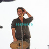 ATLANTIC CITY, NJ - JULY 04:  John Stamos stands on drum set to view audience as the  Beach Boys perform for an estimated 50,000 fans in front of the Atlantic City Hilton on July 4, 2008 in Atlantic City, New Jersey.