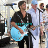 ATLANTIC CITY, NJ - JULY 04:  John Stamos sings and plays guitar with the Beach Boys as they  perform for an estimated 50,000 fans in front of the Atlantic City Hilton on July 4, 2008 in Atlantic City, New Jersey.