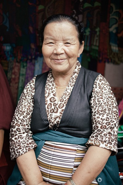 "Dolma, 65, McLeod Ganj, India. <br /> <br /> ""I know everyone in McLeod Ganj, even the tourists"". <br /> <br /> Dolma has lived in India most of her life. As a small child, she trekked across the Himalayas with her parents in search of a new home. She remembers the journey being extremely difficult but she's happy here now, even though she misses Tibet.<br /> <br /> If you ever visit McLeod Ganj, keep an eye out for Dolma - she's the lady with a big-warm smile and a very generous nature. <br /> <br /> 2015."