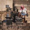 Water man steps from the Ganges