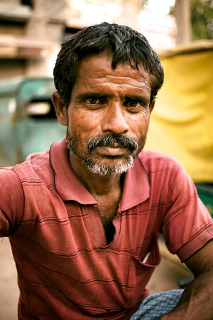 Delhi rickshaw riders endure incredibly hot and tough conditions. Sharing his picture with me was a real gift.   2014.