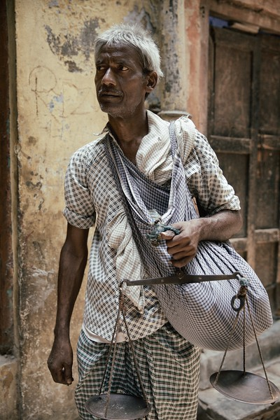 "Amar Singh, 40, Delhi, India.<br /> <br /> ""This job is tough"" <br /> <br /> Amar Singh goes door-to-door selling chick peas. He moved to Delhi 20 years ago as there was no work in Uttar Pradesh.<br /> <br /> 2015"