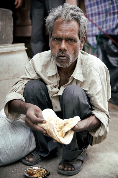 Fareed, 55, Delhi, India.<br /> <br /> Near the Jama Masjid mosque is a street where ordinary people of Delhi are able to buy meals for the less fortunate. It's humbling to see people from many walks of life offering such a simple, yet important gift. Its also very confronting however, to see the large number of people who are hungry and facing dire circumstances.<br /> <br /> Most people queueing for food shy away from the camera and understandably so, however Fareed wanted to share something of his life. And that something entailed living on the street with no friends, family, or income and just two basic meals a day donated by complete strangers. Fareed told me he couldn't find any work as he was unskilled and said he had relatives but he didn't know where.<br /> <br /> There was so much I wanted to ask Fareed, but to be honest I was lost for words as he was on the brink of tears and could no longer converse. In the end the sadness that engulfed him said it all.<br /> <br /> 2015.