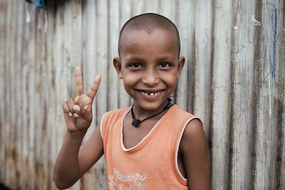 Kisan Gupta, 8, lives on the shipping docks in Darukhana. The living and working conditions here are some of the toughest in Mumbai. In spite of this, happiness and beauty still shine through with surprising frequency.  2015.