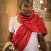 Hindu priest prepares for service