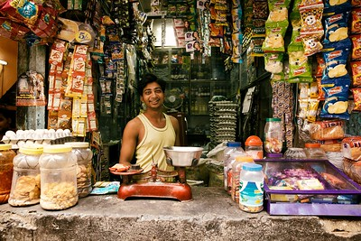 "Vinod, 23, Delhi, India.  ""I want to stay here … this is home"".  Vinod was an extremely cheerful young guy who seemed very content. His family owns 2 shops and when I asked what he wanted to do in the future, his answer was ""this"". That's when I realised why Vinod was happy.   2014."