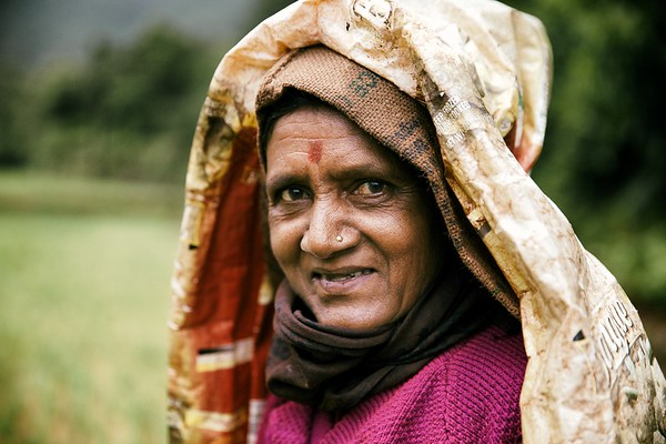 This lady and her husband were tending to their rice paddy on the banks of the Mulshi, Pune, India.   2014