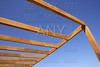 blue sky wooden golden awning beams