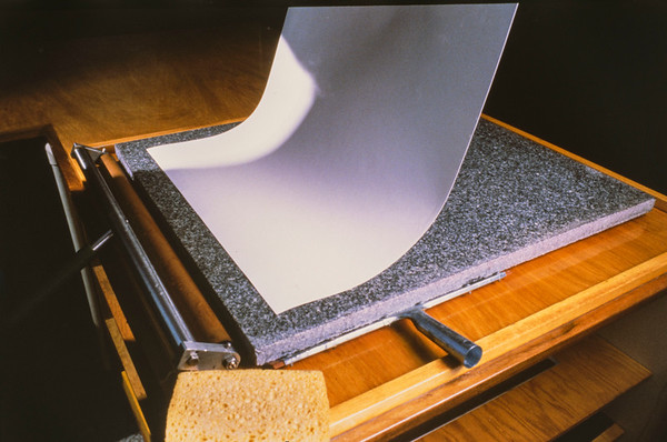 Layer prepared printing paper on the granite transfer board.
