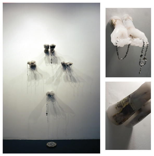 """Lord, hear our prayer""<br /> Mixed Media Installation <br /> embedded objects in paraffin wax<br /> prayer-wrapped rosaries, <br /> gold communion plate<br /> 4 sets of hands: <br /> man, woman, boy, girl<br /> 33"" x 71"" x 11""d   /  Feb 2006"