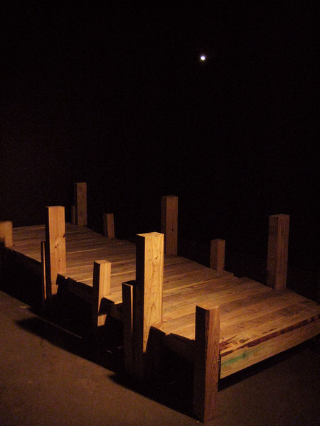 "Letting Go, 12/07/07, 2008<br /> Interactive Installation: wood, fog, water, & shining star<br /> 14ft x 5ft x 4ft  <br /> <br /> ""I had hopes of finding you, but with each day that passed, the hope for that miracle began to fade. I remember thinking to myself, as I searched thru the woods for you, and while walking out to the end of each pier –- saying…. ""He's gone.""  But then I looked up at the sky, and I saw that one bright star - and I just knew, that it was you - shining down on me. "" <br /> <br /> In Memory of my ""little brother"", Cesar Martin Montano 11/28/80 – 12/07/07.<br /> <br /> Florida Coast News<br /> Body Of Missing Boater Found In River 11:30 am EST December 12, 2007 <br /> <br /> The search for a 27-year old boater who fell in the St. Johns River last week ended Wednesday morning when a Florida Fish and Wildlife Conservation Commission officer found his body floating in Palmo Cove. The FWC was told Cesar Montano fell off his sailboat while trying to refuel it with a gas can while under way. Montano and his wife, Jennifer, were on a 12-day trip that began in Miami. They were heading from Jacksonville to Welaka when he fell into the river early Friday morning. <br /> <br /> Five agencies had officers using boats and aircraft all weekend in the search for the 27-year-old man. The body was spotted 10:30 a.m. Wednesday about two miles from the original search site. The St. Johns County Sheriff's Office dive team was called to retrieve the body. The FWC, the investigating agency, said an autopsy would be conducted to determine the cause of death."
