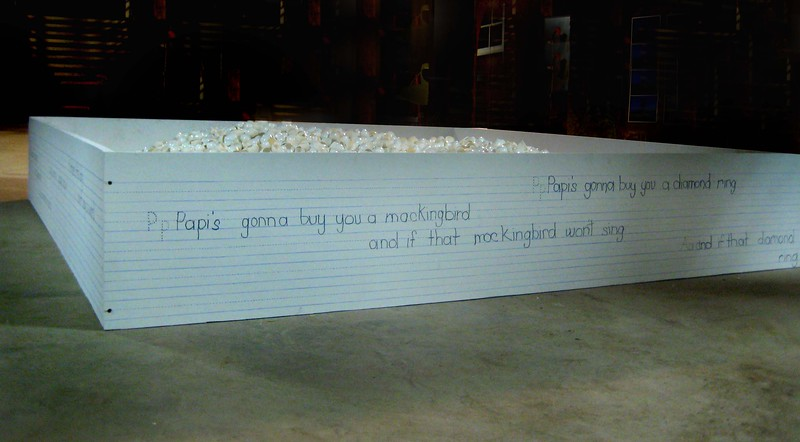 """Playing on Eggshells""<br /> Interactive Installation<br /> Guests are invited to play within 12,000 plastic eggshells (in lieu of walking on eggshells.)  <br /> Father's Lullaby inscripted on wood frame with child's handwriting. <br /> 96""x 96"" x 17'h"