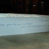 """""""Playing on Eggshells""""<br /> Interactive Installation<br /> Guests are invited to play within 12,000 plastic eggshells (in lieu of walking on eggshells.)  <br /> Father's Lullaby inscripted on wood frame with child's handwriting. <br /> 96""""x 96"""" x 17'h"""