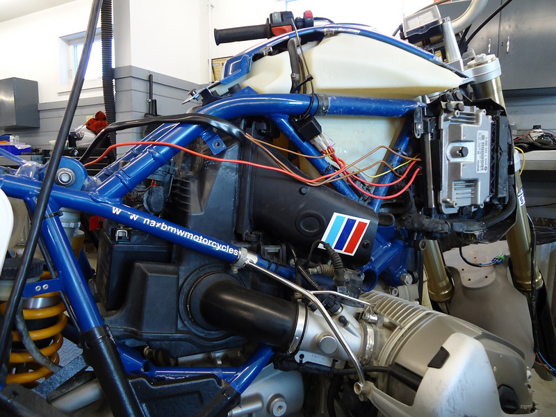 Start by laying the wiring harness out along the right side of the bike.<br /> It will tuck in under the frame rails and behind the ECU as it goes forward from the battery to the front of the bike.<br /> The harness has been pre-built so this should be a simple task of running it along it's path and making the connections.