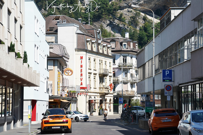 Vignette of downtown Interlaken with an amber hued Lamborghini lending color to this very archetypical Swiss street scenario!