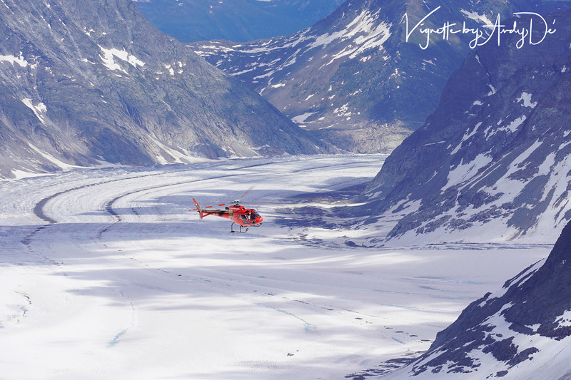 Compelling shot of this Helicopter encircling the the Aletsch glacier, bordered by four thousand-meter peaks, as seen from the Jungfraujoch!