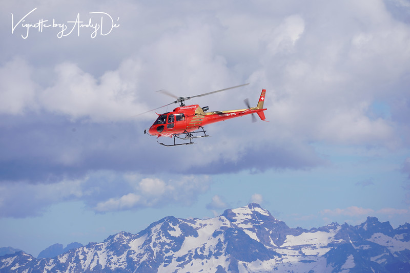 A helicopter looms large over the peaks of the Jungfraojoch, presenting a breath taking spectacle!