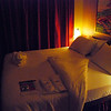 Carnival Dream Southern Caribbean Cruise Spa Deck 11 room 11214 with spa slippers on bed balcony state room spa room 11214 CLOUD 9 SPA PHOTOS