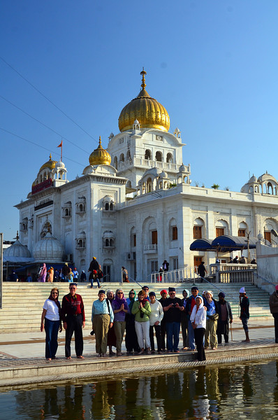 A Gurdwara (Punjabi: ਗੁਰਦੁਆਰਾ, gurduārā or , gurdwārā), meaning the Gateway to the Guru, is the place of worship for Sikhs,[1] the followers of Sikhism. A Gurdwara can be identified from a distance by tall flagpoles bearing the Nishan Sahib (the Sikh flag, see image at lower right). Gurdwara New Delhi