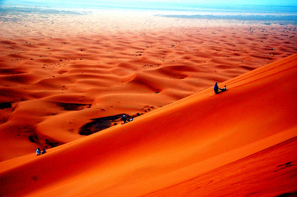 "doing the ""berber slide"" down the dunes ""erg chebbi"" in the Saraha desert, Morocco."