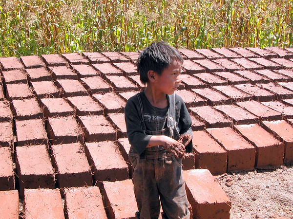 child making adobe