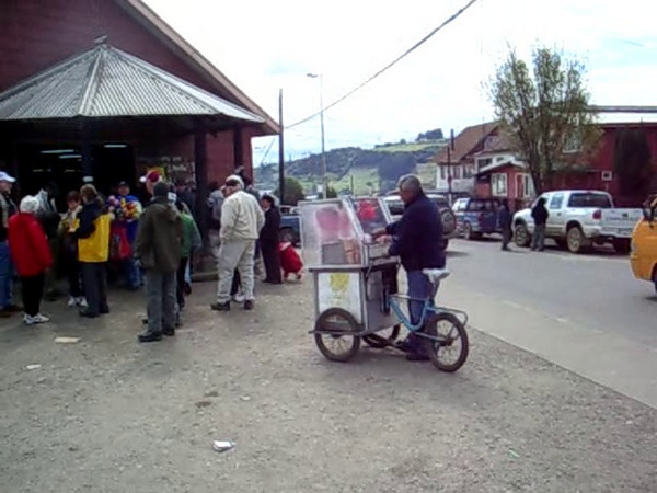 Chiloe, Chile. Manual cotton candy machine. Watch as he spins the cotton candy.