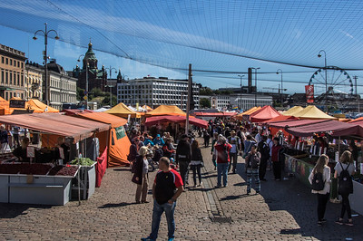 Helsinki's famous open air market on the waterfront.  Huge array of food, produce, and other merchandise are available.   Fishermen dock on the waterfront edge to the market and sell their fish right off the boats.