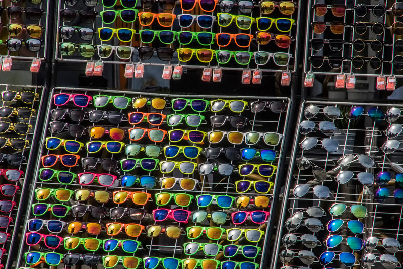 Colorful display of glasses contrast with traditional gift shops.