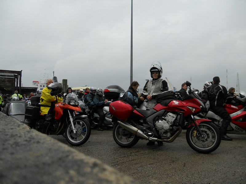 Waiting with others to board the ferry.