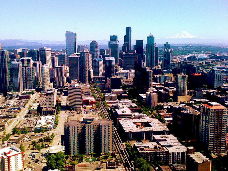 "Downtown Seattle with Mt. Rainier in the background, taken from the Space Needle.  iPhone 3G (Pardon the noise!)<br /> 7/9/2010<br /> Thank you all for all your comments on yesterday's Space Needle and my earlier iPhone images.  I've been challenging myself to take and edit better pictures with just the iPhone to test my philosophy that ""Your most valued photo gear is what's under your hat!"".<br /> <br /> I finally had some time late last night to comment but shortly into it, Smug went into maintenance mode so I'll catch up soon.  Your work never ceases to amaze!  Heading home tonight."
