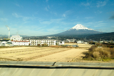 Fuji san. Taken from the Shinkansen at full speed. (Post processing: Angle & slight cropping, noise reduction.)